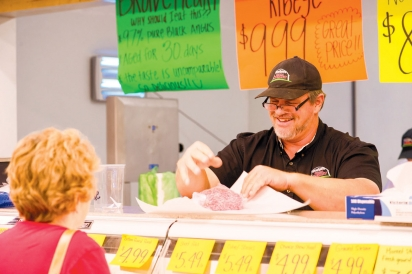Owner Henry Sr behind the butcher counter.
