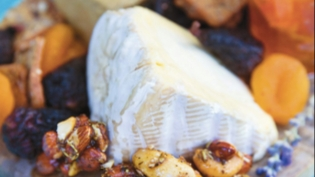 cheese board with honey-herb candied nuts